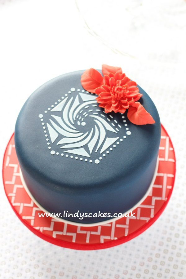 Simple stencilled hexagon cake in red, white and blue